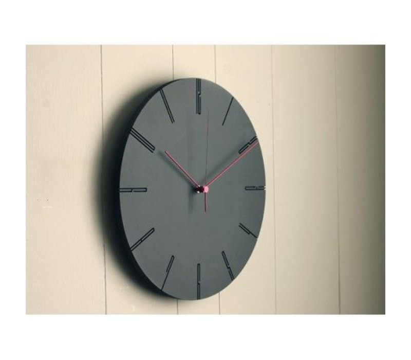 Modern clock 'Carved II' is available in two colors; black and white.