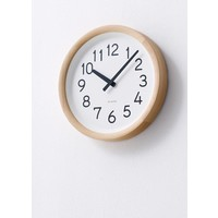 Round wooden wall clock available in natural wood or black-finish