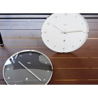 Modern wall clock in aluminium and glass