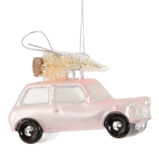 Rosafarbenes Auto mit Weihnachtsbaum