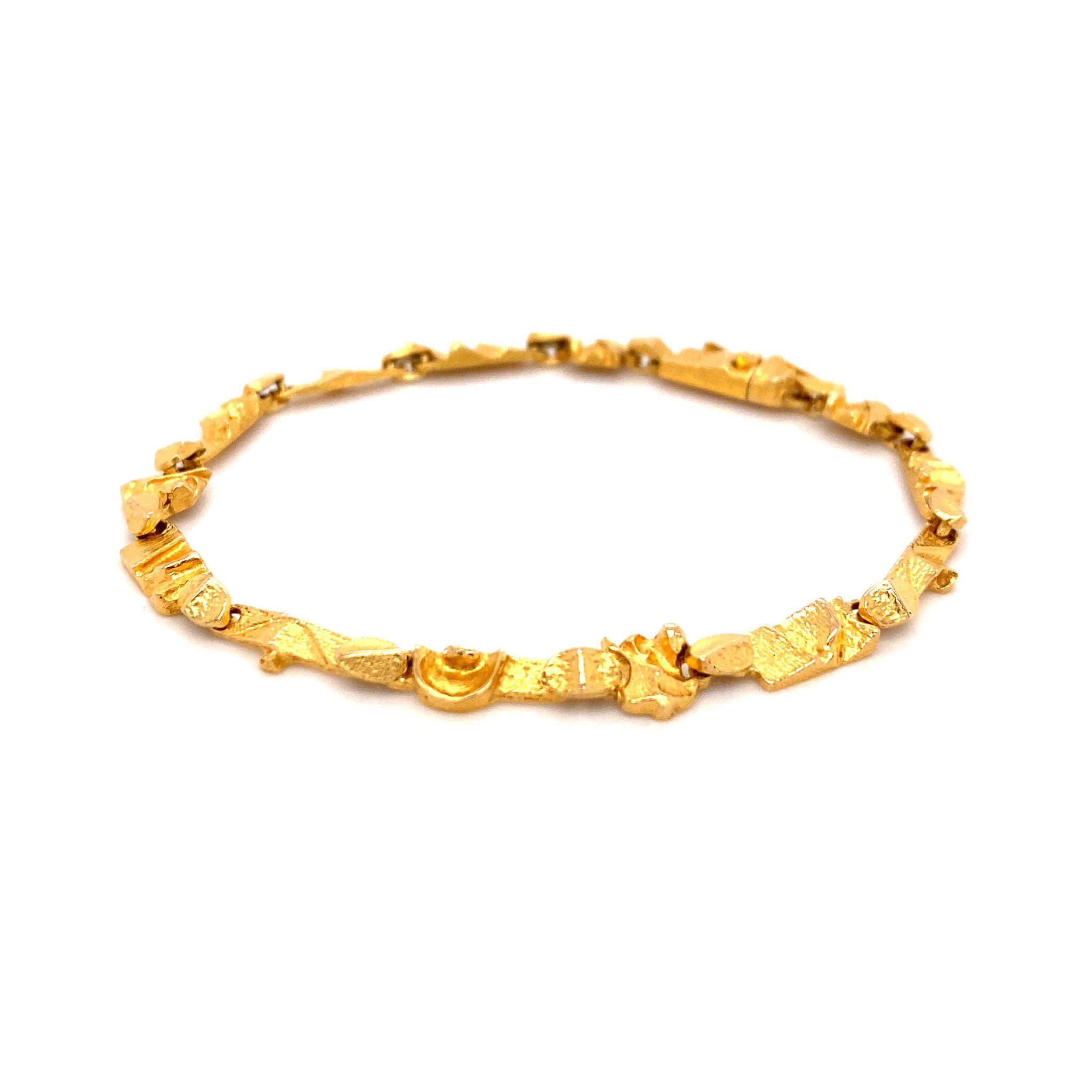 Lapponia Lapponia Tenochtitlan 14 krt. geelgouden armband 18,5 cm.