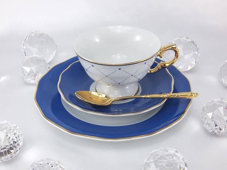 Marie Josée porcelain line in cobalt blue with gold rim