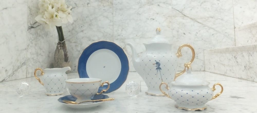 Marie Josée porcelain collection in cobalt blue with gold rim
