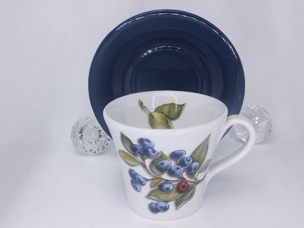 Coffee cup with saucer with pattern