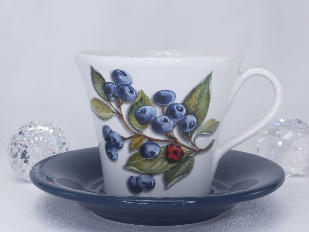 Kaffeetasse mit Untertasse  mit Muster