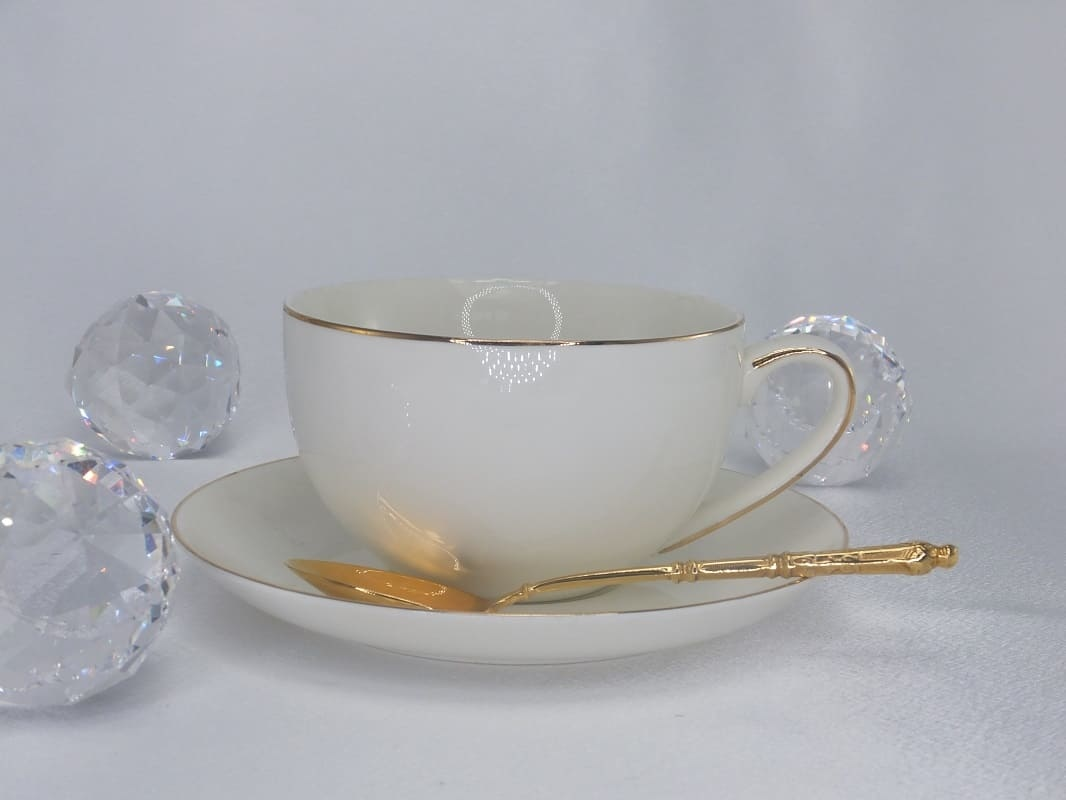 CARMANI - 1990 Teacup with saucer in white / gold