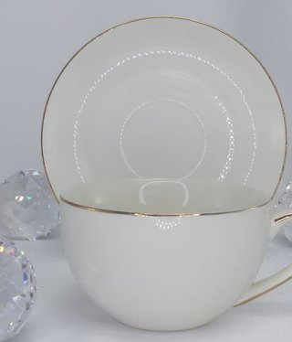 CARMANI - 1990 Teacup with saucer- white / gold