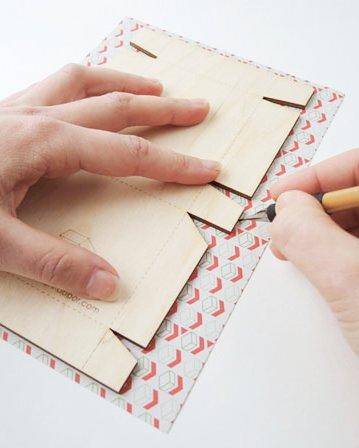 Pakje papier voor de houten mallen