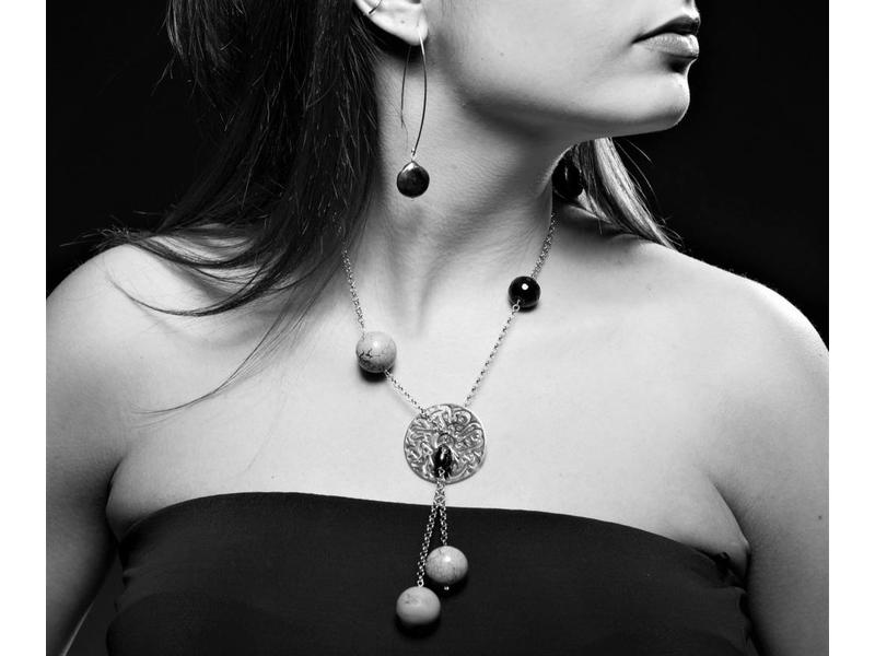 ASYMMETRY WITH LARGE SILVER DISC AND FIVE GEMSTONES