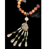 NECKLACE WITH ARABESQUE AND TASSELS