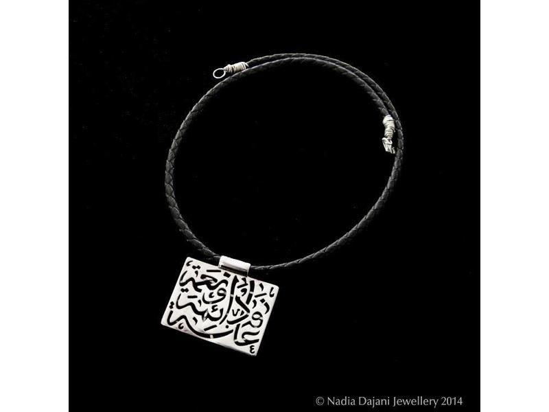 NIMAH SQUARE NECKLACE ON LEATHER