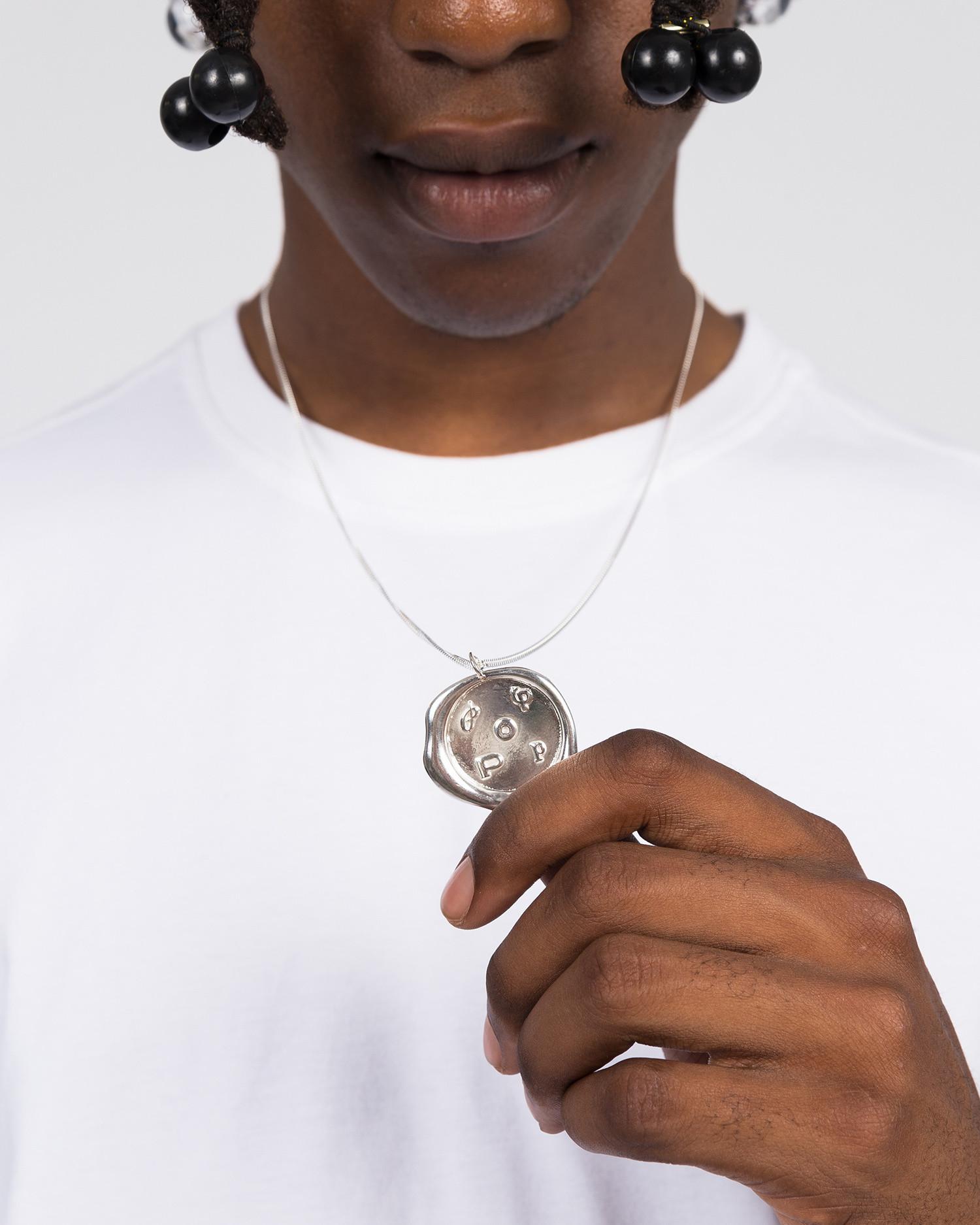 Pop Trading Co X parra silver pendant