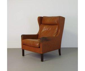 Vintage deense fauteuil cognac leer met oren de machinekamer