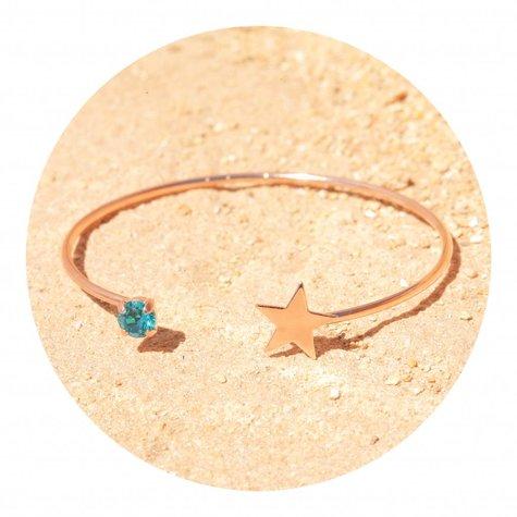artjany Armreif mit einem Kristall & einem Stern in blue zirkon