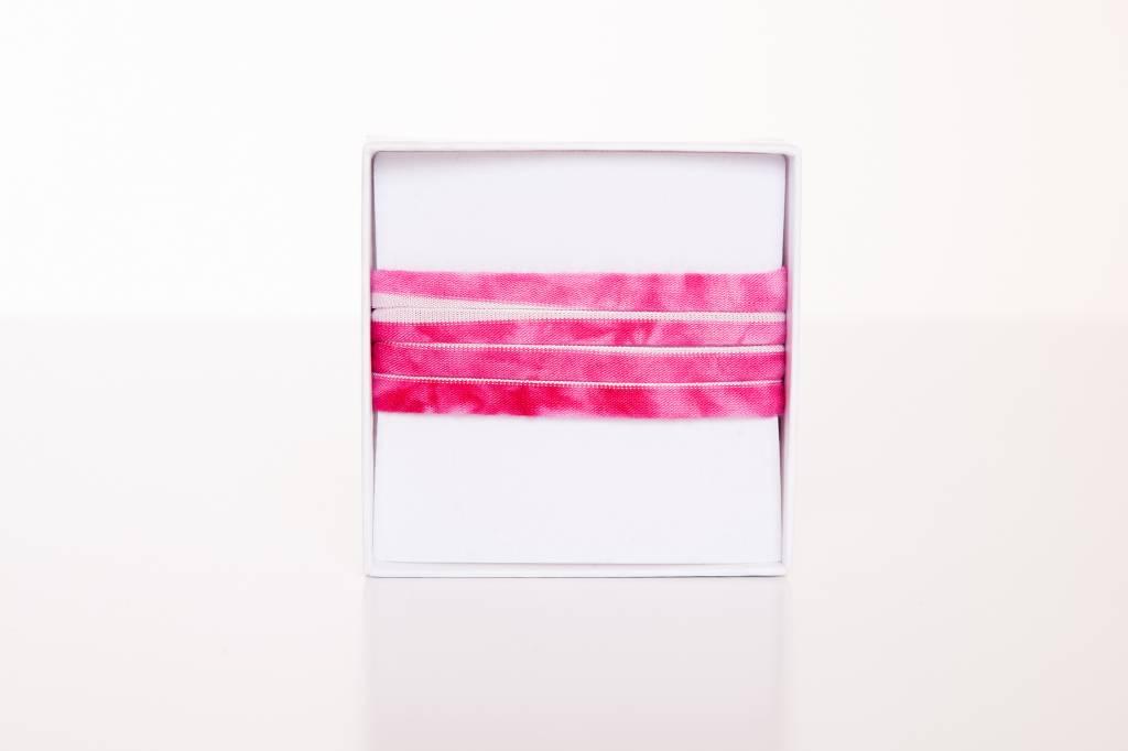 Pink-Weiß längs gestreift