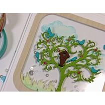 Punzonatura e goffratura stencil albero con gli uccelli