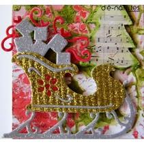 Coupe et gaufrage pochoirs traîneau de Noël avec des cadeaux