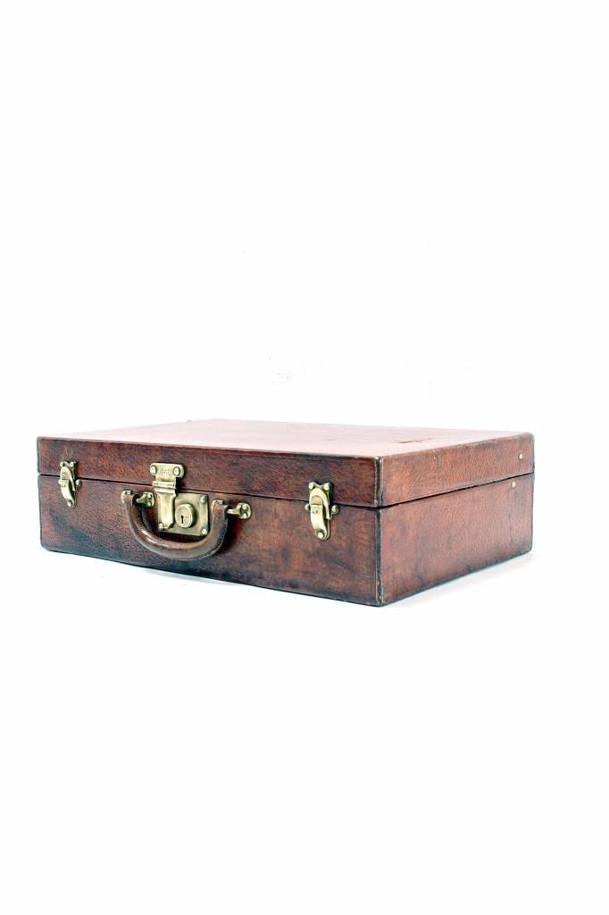 Antique leather Louis Vuitton travel suitcase