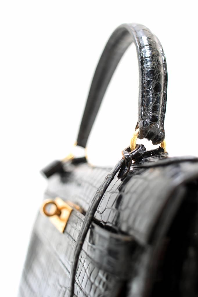 Vintage Hermès Kelly bag and clutch in black croco