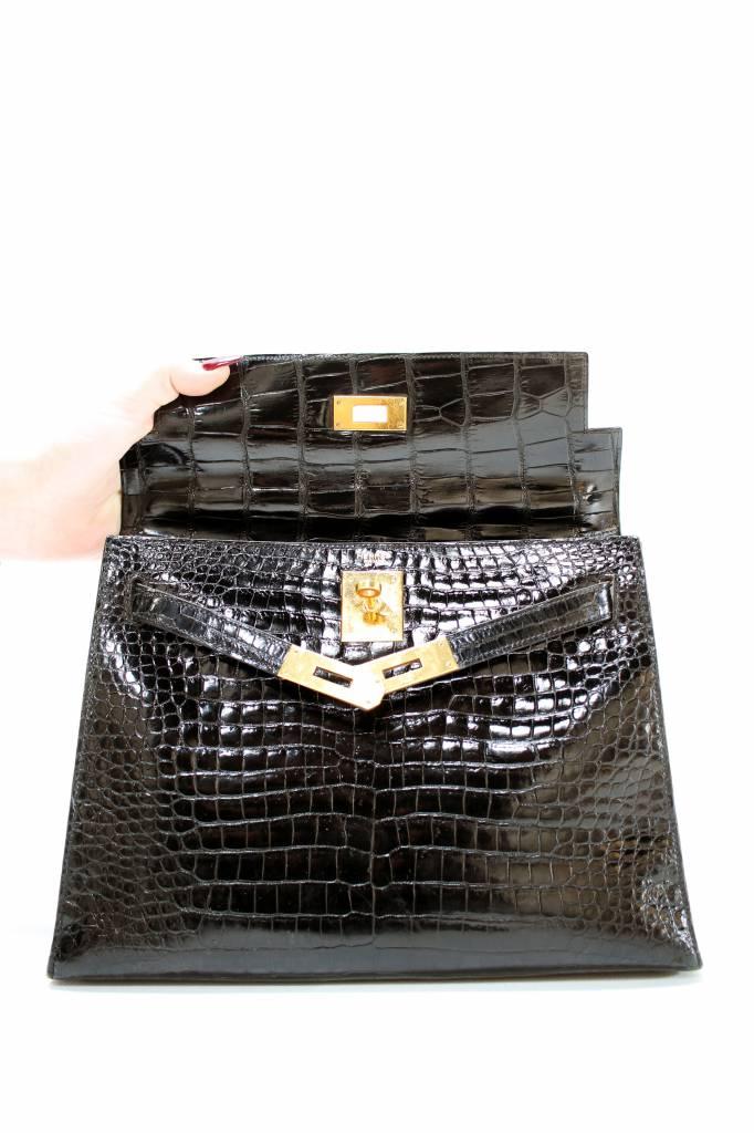 Vintage Hermès Kelly bag en clutch in zwarte croco