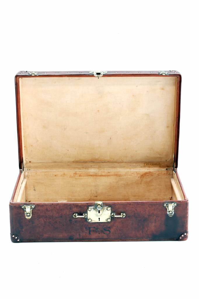 Old leather Louis Vuitton suitcase