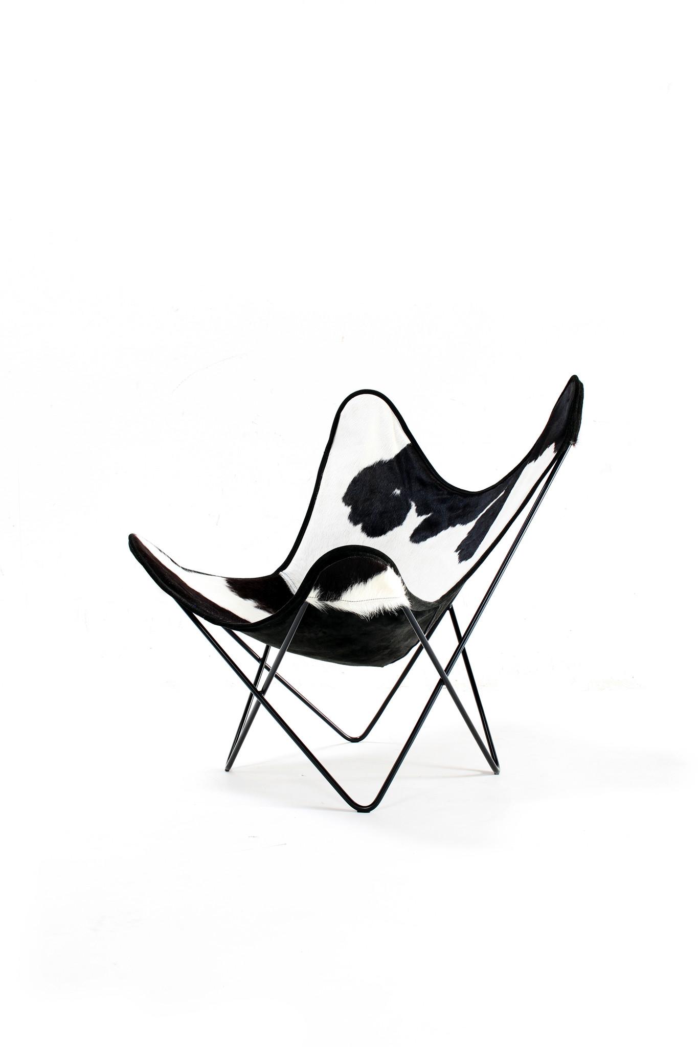 """Design vlinderstoel met koeienhuid hoes """"plux"""""""