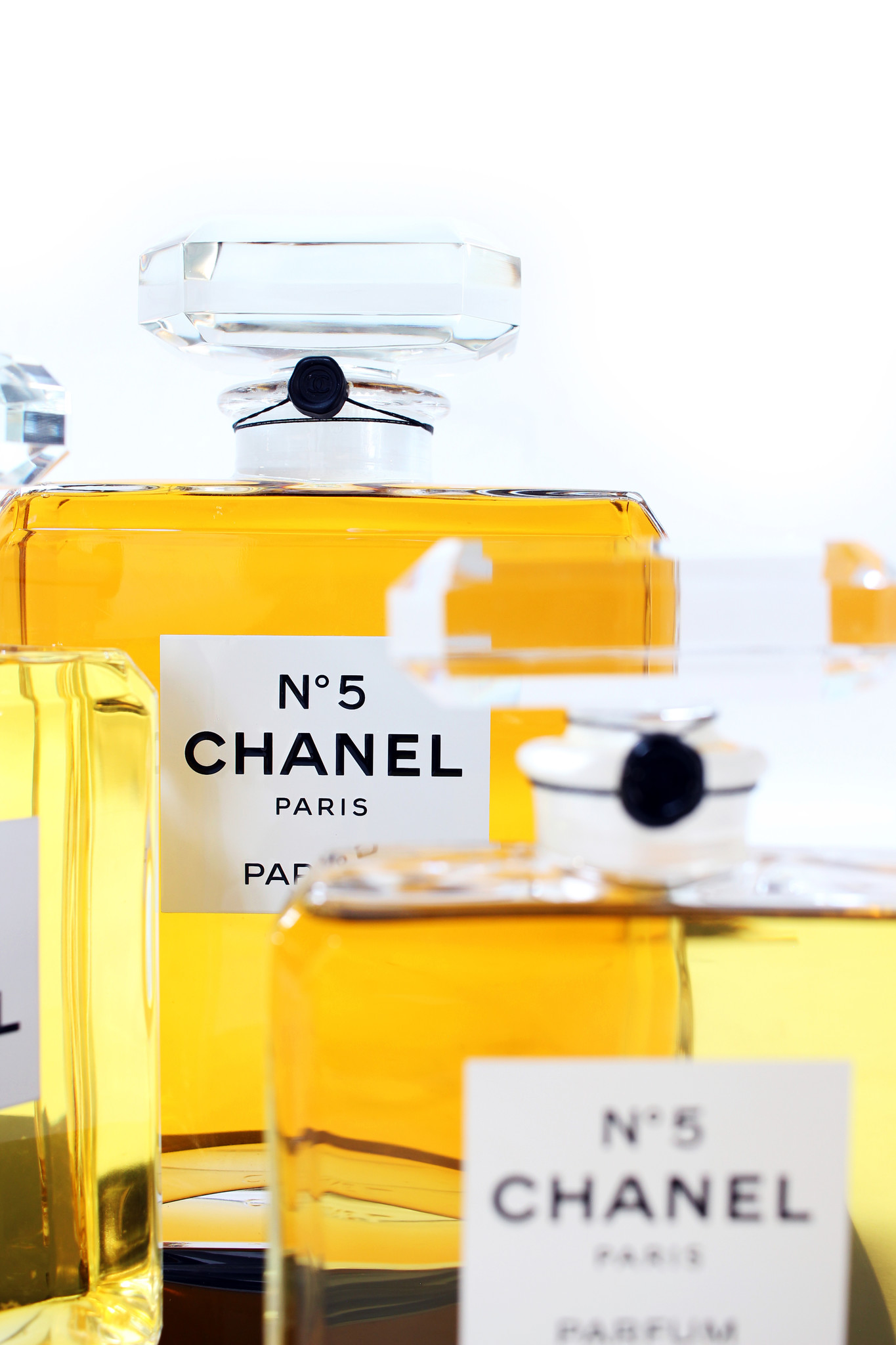 Large Chanel perfume bottles in display case