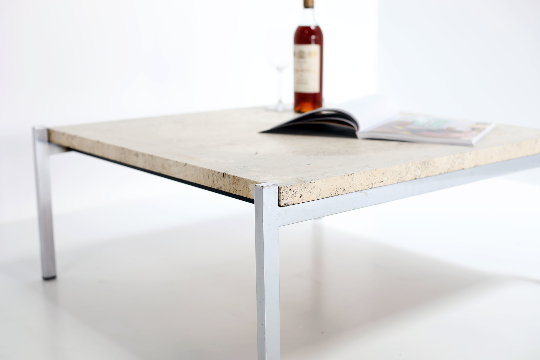 Sober vintage coffee table with travertine top