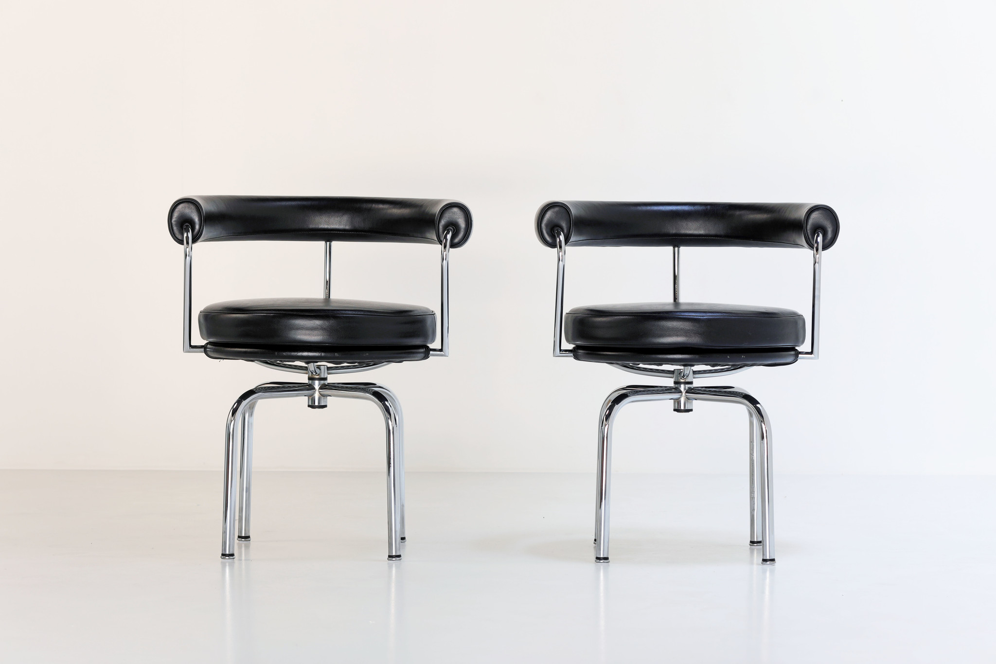 LC7 swivel armchairs by Le Corbusier, Perriand Jeanneret for Cassina