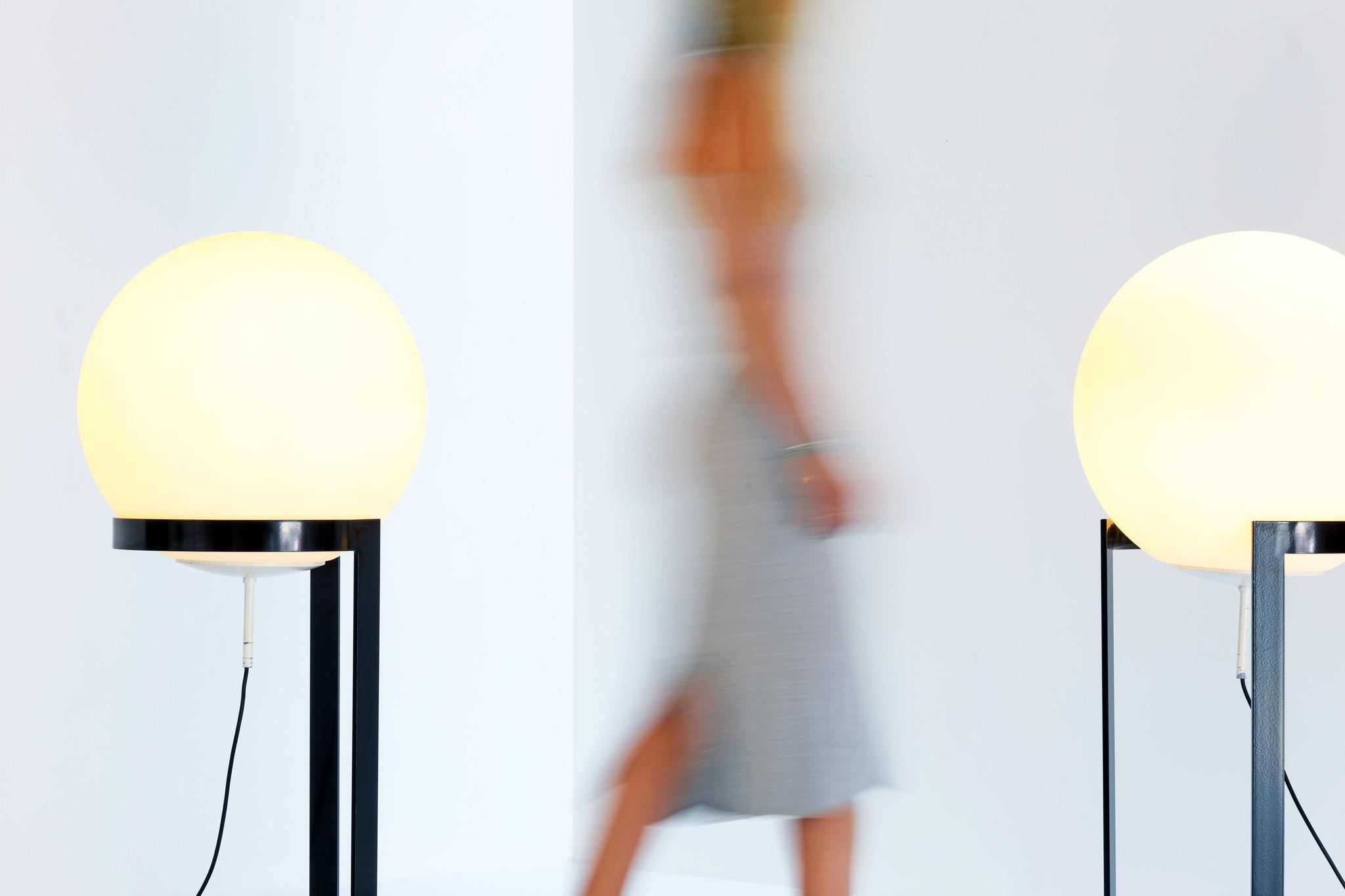 "Vintage ""Globe"" design floor lamps on foot."