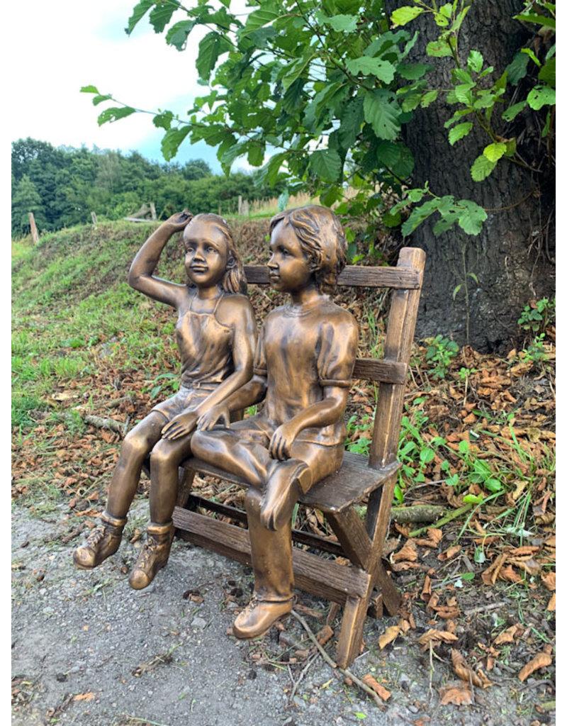 Hans und Greta auf Bank – Bronzeskulptur
