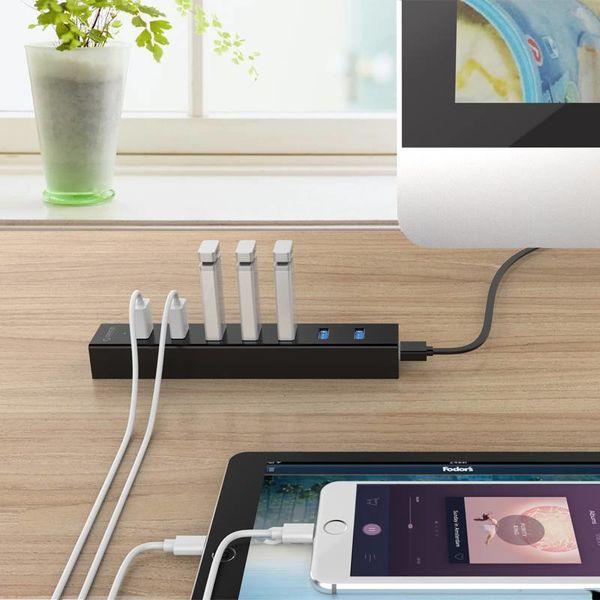 Orico Hub USB 3.0 avec sept ports design noir mat avec 1m 5Gbps câble de données USB 3.0 et câble d'alimentation USB supplémentaire