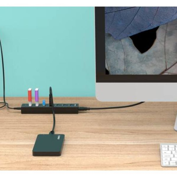 Orico USB 3.0 hub with 7 ports in matt black design with 1 meter 5Gbps USB 3.0 data cable and extra USB power cable