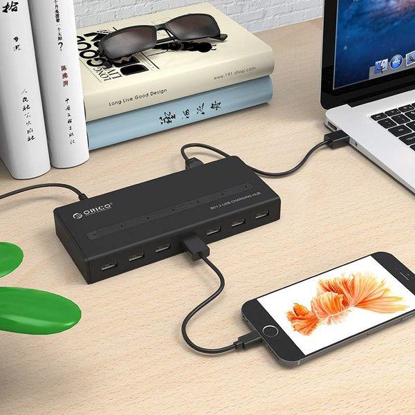 Orico USB 3.0 hub met 7 poorten en BC 1.2 laadfunctie in mat zwart design met 1 meter 5Gbps USB 3.0 datakabel en stroom adapter