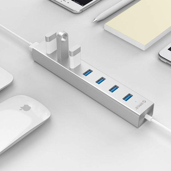 Orico Aluminium USB3.0 Hub mit sieben Typ-A-Ports - 5 Gbps - VIA-Chip - funktioniert mit Windows, Linux und Mac OS - Mac Style - inkl 10W Adapter / 1M Datenkabel -. Silber