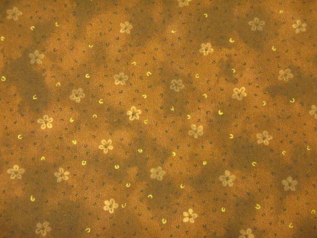 Stoff ockerfarbene Blumen auf braun