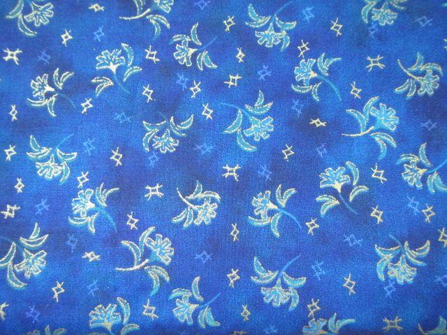 Stoff goldgerandete Blumen auf blau