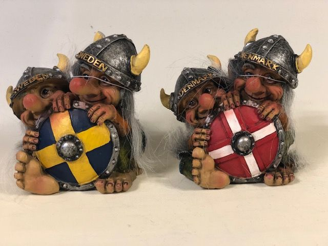 Troll behind the Denmark shield