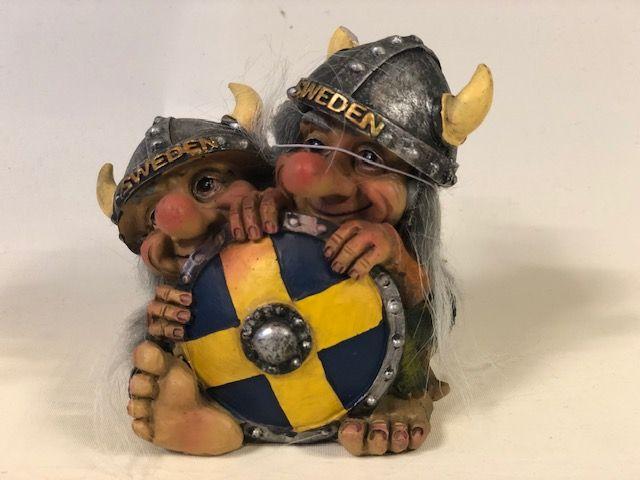 Troll behind shield Sweden