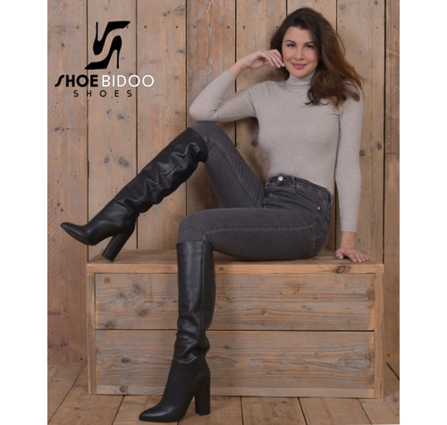Olga in Italian knee boots