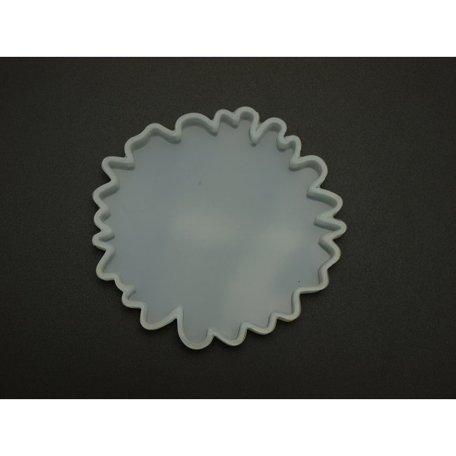Silicone mold (23) irregularly shaped 8.7 cm. thickness 0.8 cm.