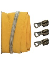 coil zipper ocre - shiny anti-brass 100cm including 3 sliders