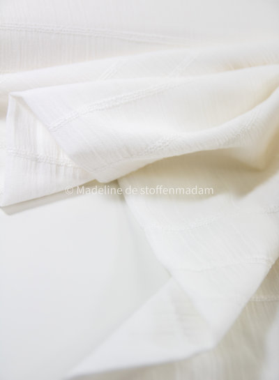 white - cotton  with embroidered lines