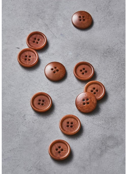 Meet Milk rust - dish corozo button - 25 mm
