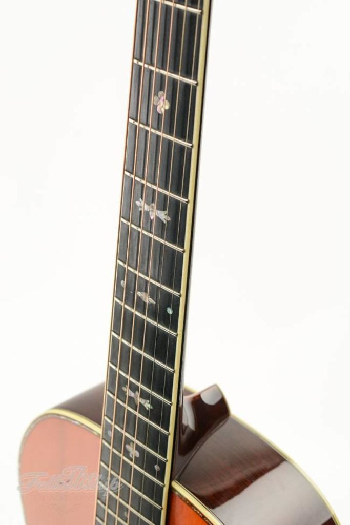What is the difference between a 12 and a 14 fret guitar?