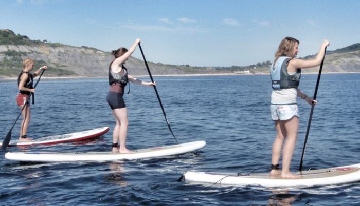 Stand Up Paddleboarding with Boylos- SUP Lessons in Lyme Regis