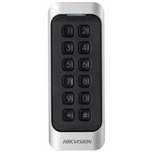 The DS-K1107EK is a card reader with code keys from the access control line of Hikvision. The card reader can be connected via RS-485 or Wiegand. The beautifully designed card reader can be used both indoors and outdoors. The card reader can read MiFare c