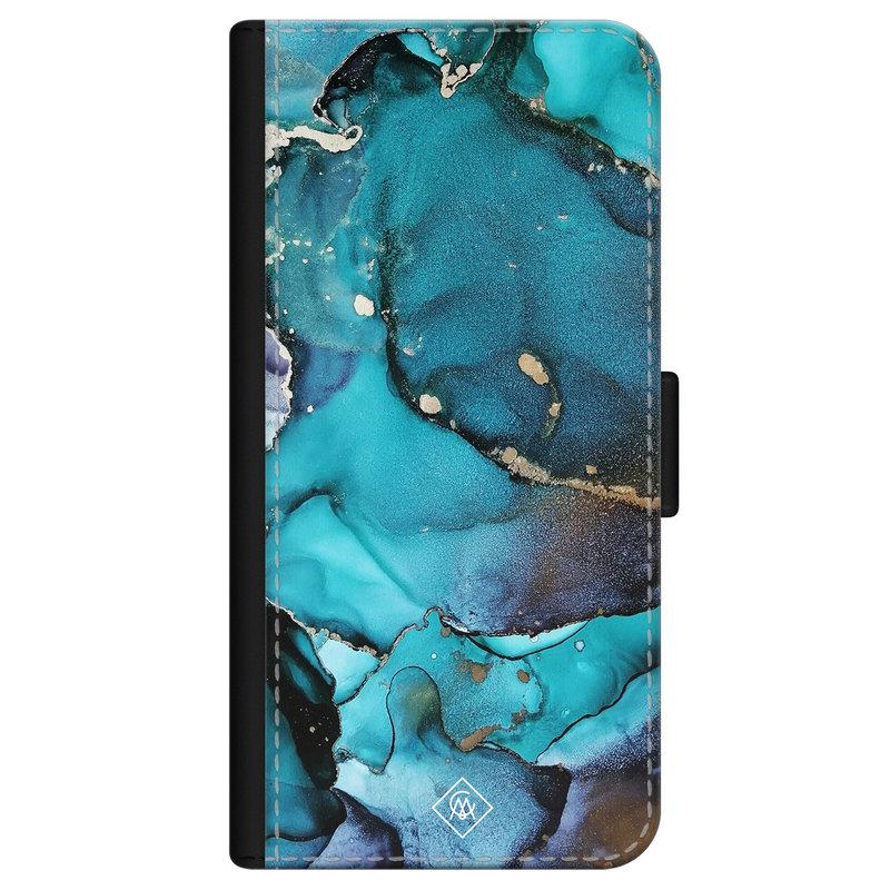 Casimoda iPhone 12 flipcase - Marmer indigo blauw