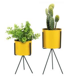 Gele plantenstaander