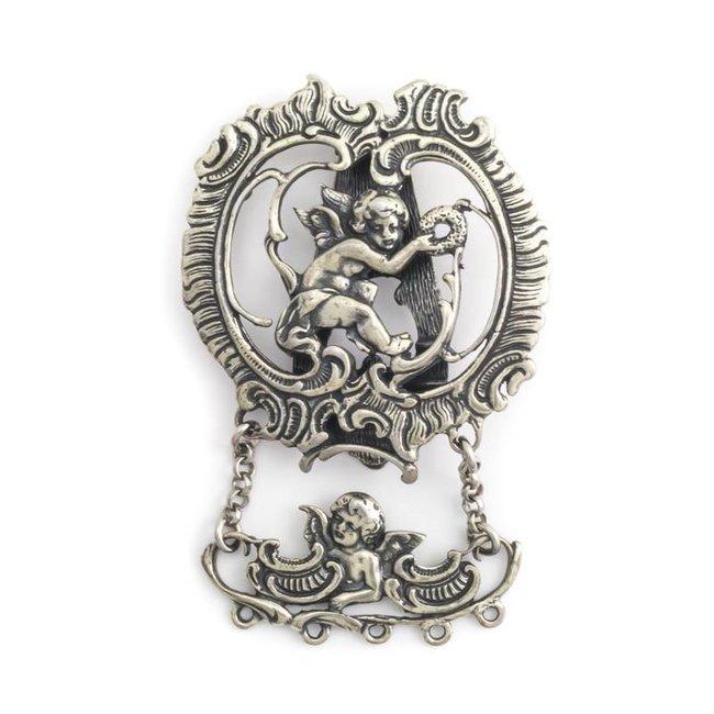 Zilveren roksteker met cherubijntjes